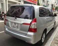 Cần bán gấp Toyota Innova 2.0E năm 2014, màu bạc giá 580 triệu tại Hà Nội