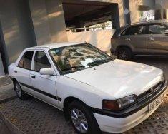 Bán xe Mazda 323 sản xuất 1995, màu trắng giá 70 triệu tại Tp.HCM