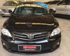 Bán Toyota Corolla Altis 1.8AT năm sản xuất 2014, màu đen, giá tốt. giá 610 triệu tại Tp.HCM