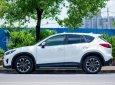 Nhà mình cần ra đi con Mazda CX5 2.5 đời 2016, số tự động, một cầu, bản full, màu trắng