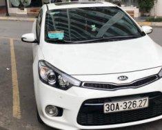 Cần bán lại xe Kia Cerato 2.0 AT đời 2014, màu trắng  giá 690 triệu tại Hà Nội