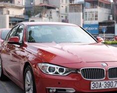 Bán xe BMW 3 Series 320i 2012, màu đỏ, nhập khẩu nguyên chiếc giá 860 triệu tại Hà Nội