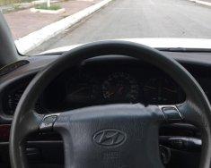 Cần bán lại xe Hyundai Grandeur năm 2003, màu trắng, nhập khẩu số tự động, 76 triệu giá 76 triệu tại Hà Nội