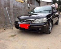 Cần bán gấp Ford Laser Ghia 1.8 AT đời 2005, màu đen chính chủ giá 235 triệu tại Lâm Đồng