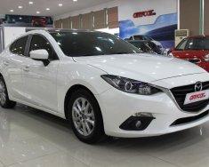 Bán xe Mazda 3 1.5AT Sedan đời 2015, màu trắng, giá tốt giá 604 triệu tại Hà Nội