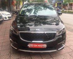 Cần bán xe Kia Sedona sản xuất 2015, màu đen chính chủ giá 975 triệu tại Hà Nội