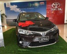 Corolla Altis 1.8E CVT giá tốt, tặng phụ kiện chính hãng, hỗ trợ trả góp lãi suất thấp giá 690 triệu tại Hà Nội