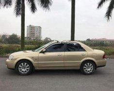 Cần bán gấp Ford Laser GHIA 1.8 AT năm sản xuất 2004, màu vàng số tự động, 238 triệu giá 238 triệu tại Hải Phòng