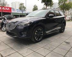 Chính chủ bán Mazda CX 5 2.5 AT AWD đời 2016, màu xanh lam giá 890 triệu tại Hà Nội
