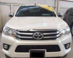 Bán Toyota Hilux 2.8G 4x4 MT năm 2016, màu trắng, nhập khẩu   giá 810 triệu tại Tp.HCM