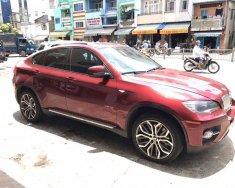 Cần tiền bán BMW X6 2010 màu đỏ cực đẹp giá 868 triệu tại Tp.HCM