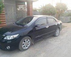 Cần bán gấp Toyota Corolla Altis 1.8MT đời 2011, màu đen chính chủ, giá tốt giá 462 triệu tại Nghệ An