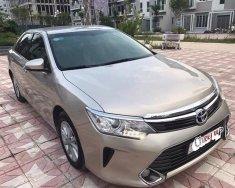 Bán Toyota Camry 2.0E đời 2016, màu vàng giá 925 triệu tại Hà Nội