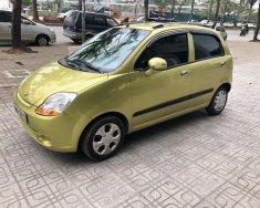Chính chủ bán xe Chevrolet Spark LT 1.0 MT Super 2011, màu vàng giá 138 triệu tại Hà Nội