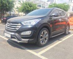 Bán xe Santa Fe nhập HQ bản 4WD 2014, màu đen giá 910 triệu tại Tp.HCM