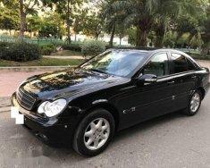 Cần bán xe Mercedes C180 Kompressor đời 2003, màu đen, giá 250tr giá 250 triệu tại Tp.HCM