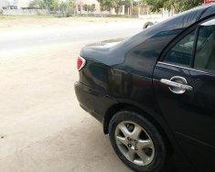 Cần bán lại xe Toyota Corolla altis đời 2005, màu đen giá 315 triệu tại Tp.HCM