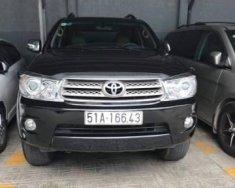 Bán Toyota Fortuner V2.7 AT sản xuất năm 2011, màu đen giá 610 triệu tại Tp.HCM