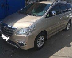 Cần bán Toyota Innova 2.0E đời 2014, màu bạc số sàn giá 568 triệu tại Tp.HCM