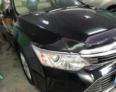 Bán Toyota Camry 2.0E sản xuất 2015, màu đen chính chủ giá 880 triệu tại Hà Nội