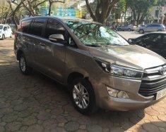 Bán ô tô Toyota Innova sản xuất năm 2016, màu nâu chính chủ giá cạnh tranh giá 710 triệu tại Hà Nội