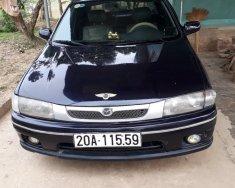 Bán Mazda 323 G sản xuất 1999, màu xanh lam, nhập khẩu nguyên chiếc xe gia đình giá 70 triệu tại Hà Nội