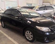 Bán Toyota Corolla altis 1.8G AT năm 2014, màu đen giá 610 triệu tại Tp.HCM