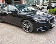 Chính chủ bán xe Mazda 6 2.0L Premium đời 2017, màu đen giá 905 triệu tại Hà Nội