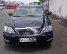 Bán xe Toyota Camry sản xuất 2004 màu đen, xe nhập giá 385 triệu tại Tp.HCM