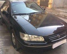 Cần bán gấp Toyota Camry sản xuất năm 2000, màu đen giá 300 triệu tại Hải Phòng