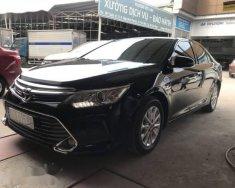 Bán Toyota Camry 2.0E đời 2016, màu đen  giá 918 triệu tại Tp.HCM