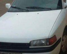 Cần bán gấp Mazda 323 năm 1996, màu trắng, nhập khẩu, xe gia đình giá 60 triệu tại Đắk Lắk