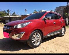Cần bán xe Hyundai Tucson 2.0AT sản xuất năm 2010, màu đỏ, nhập khẩu giá 590 triệu tại Gia Lai