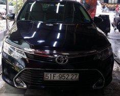Cần bán xe Toyota Camry 2.0E đời 2016, màu đen giá 900 triệu tại Tp.HCM