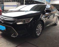 Cần bán Toyota Camry 2.0E năm 2016, màu đen giá 918 triệu tại Tp.HCM