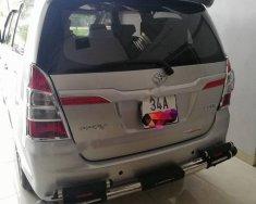 Cần bán gấp Toyota Innova 2.0E đời 2014, màu bạc xe gia đình giá 575 triệu tại Hải Dương