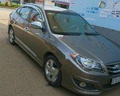 Bán xe Hyundai Avante sản xuất năm 2011, màu vàng xe gia đình giá 380 triệu tại Đồng Nai