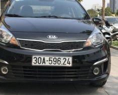 Cần bán lại xe Kia Rio 1.4 AT sản xuất năm 2015, màu đen số tự động, 495tr giá 495 triệu tại Hà Nội