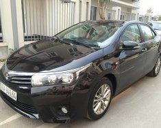 Cần bán xe Toyota Corolla altis 1.8G đời 2015, màu đen giá 699 triệu tại Hà Nội