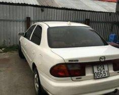 Chính chủ bán xe Mazda 323 năm sản xuất 1999, màu trắng giá 130 triệu tại Tp.HCM
