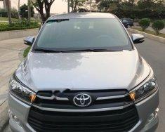 Bán Toyota Innova 2.0 MT SX 2016, màu bạc giá 733 triệu tại Tp.HCM