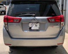 Cần bán lại xe Toyota Innova E sản xuất năm 2017, màu bạc xe gia đình giá 718 triệu tại Tp.HCM