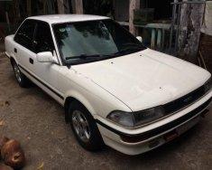 Bán Toyota Corolla sản xuất năm 1989, màu trắng, nhập khẩu nguyên chiếc xe gia đình, 92tr giá 92 triệu tại Bình Dương