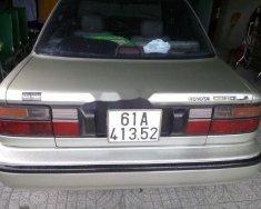 Cần bán gấp Toyota Corolla sản xuất 1988, màu ghi vàng giá 98 triệu tại Bình Dương