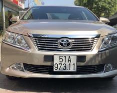 Cần bán lại xe Toyota Cảmy 2.5Q năm 2013 màu vàng, 565 triệu giá 865 triệu tại Hà Nội