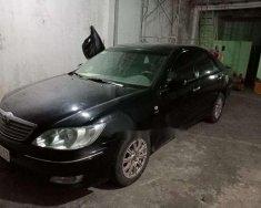 Cần bán lại xe Toyota Camry 2.4G đời 2003, màu đen số sàn, giá 320tr giá 320 triệu tại Cần Thơ