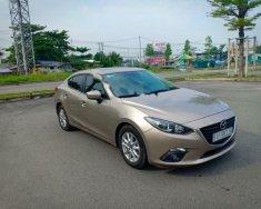 Cần bán xe Mazda 3 1.5 AT đời 2016, màu vàng   giá 615 triệu tại Bình Dương