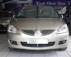 Chính chủ bán Mitsubishi Lancer Gala GLX 1.6AT 2004, màu vàng giá 240 triệu tại Hà Nội
