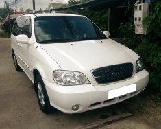 Cần bán xe Kia Carnival 2007 số sàn, màu trắng giá 305 triệu tại Tp.HCM