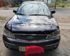 Cần bán Ford Laser sản xuất 2004, màu đen, nhập khẩu nguyên chiếc, giá chỉ 242 triệu giá 242 triệu tại Tp.HCM